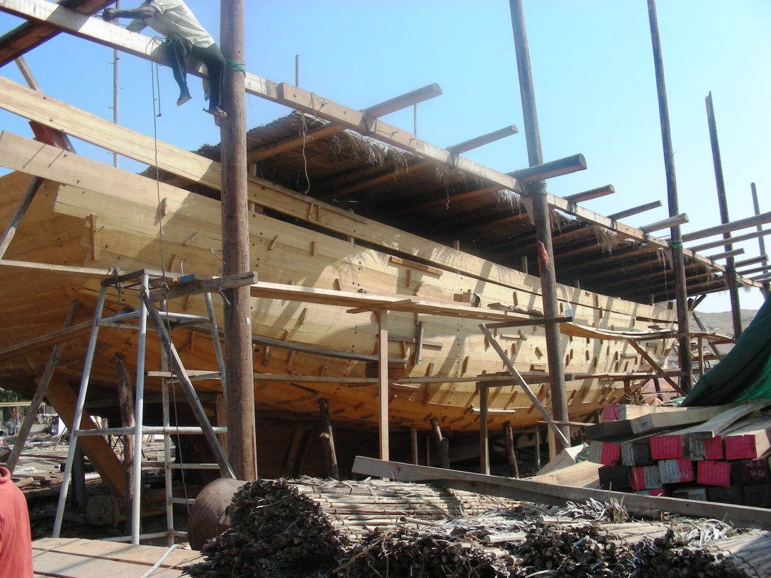 Dhow-building in progress at a traditional dhow yard in Sur, Oman